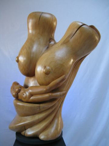 Woman in relaxation. Sculpture in wood of boxwood